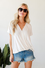 White - Model wearing a Surplice Tee with denim shorts