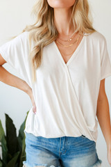 White - Dress Up model wearing a Surplice Tee with denim shorts