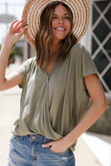 Olive - Model wearing a Surplice Tee with a straw hat
