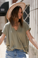 Olive - Dress Up model wearing a Surplice Tee with a straw hat