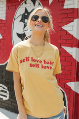 Model wearing the Self Love Graphic Tee with denim shorts