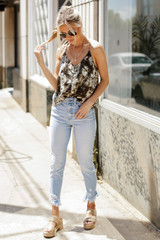 Model wearing Kancan High Waist Distressed Skinny Jeans