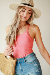 Coral - Model wearing a Ribbed Bodysuit with denim shorts