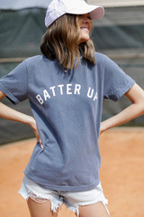 Model wearing the Batter Up Graphic Tee with denim shorts