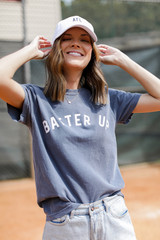 Dress Up model wearing the Batter Up Graphic Tee with denim shorts