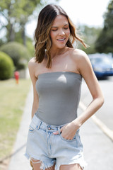 Model wearing a Strapless Bodysuit with denim shorts