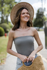 Olive - Dress Up model wearing a Strapless Bodysuit with denim shorts