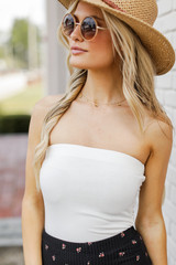 White - Dress Up model wearing a Strapless Bodysuit with a straw hat