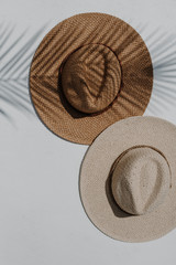 Flat Lay of both colors of a Straw Fedora Hat