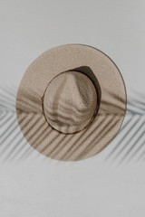 Flat Lay of an Ivory Straw Fedora Hat