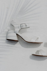 Close Up of Ankle Strap Heels in White