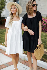 Models wearing Eyelet Tiered Dresses