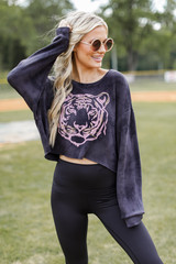 Model wearing a Tiger Cropped Pullover with leggings