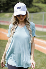 Sage - Model wearing the Everyday Tee with a baseball cap