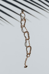 Flat Lay of a Gold Chainlink Bracelet