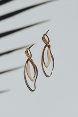 Flat Lay of Gold Statement Drop Earrings
