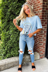Model wearing a Tiger Love Graphic Tee with jeans