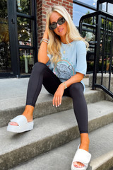Model wearing a Tiger Love Graphic Tee with black leggings