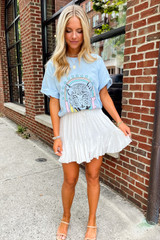Tiger Love Graphic Tee on model with white skirt