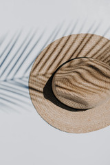 Flat Lay of a Straw Fedora Hat on a white backgound