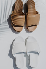Flat Lay of both colors of the Platform Slide Sandals
