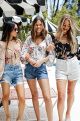 Models wearing a Floral Top