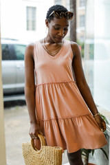 Peach - Model wearing a Tiered Dress with sunglasses
