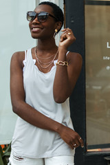 Light Grey - Dress Up model wearing the Everyday Tank with denim shorts