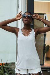 Light Grey - Model wearing the Everyday Tank with denim shorts
