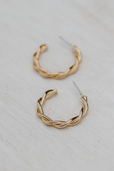 Close Up of Gold Twisted Hoop Earrings