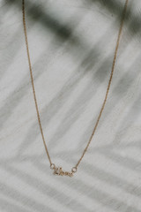 Flat Lay of a Gold Love Necklace