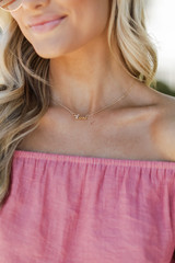 Model wearing a Gold Love Necklace
