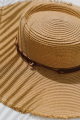 Close Up of a Frayed Straw Boater Hat in Dark Natural