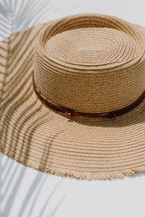 Close Up of Frayed Straw Boater Hat in Natural