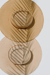 Flat Lay of both colors of the Frayed Straw Boater Hat