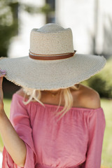 Natural - Close Up of a Frayed Straw Boater Hat