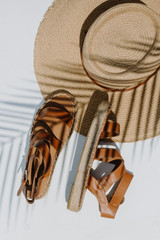 Flat Lay of Espadrille Sandals with a straw hat