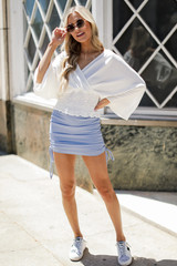 Model wearing a Ruched Mini Skirt