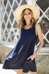 Navy - Model wearing a Swing Dress with a straw hat