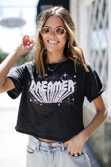 Model wearing the Dreamer Cropped Graphic Tee