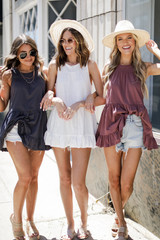 Models wearing Tiered Tanks