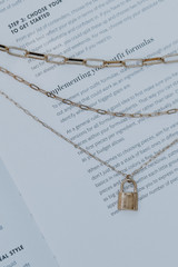 Flat Lay of a Gold Layered Lock Necklace