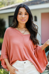 Coral - Model wearing an Oversized Knit Top