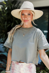 Olive - Model wearing a Cropped Tee with a straw hat