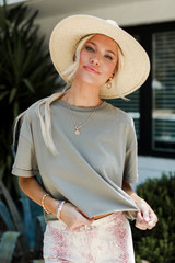 Olive - Dress Up model wearing a Cropped Tee with a straw hat