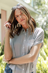 Model wearing a Striped Button-Up Top