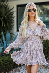 Model wearing a Floral Dress with sunglasses
