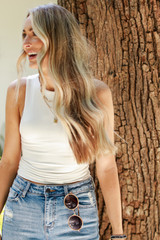 White - Model wearing the Everyday High Neck Tank with denim shorts
