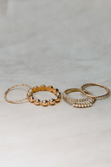 Flat Lay of a Gold Dainty Ring Set