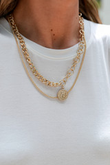 Model wearing a Gold Coin Layered Necklace